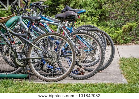 FORT COLLINS, CO - SEPTEMBER 15, 2015: A variety of  bicycles parked on  racks at a campus of Colorado State University. Bikes are popular way of commuting among students and staff.