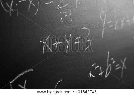 Maths Formulas On Blackboard Background
