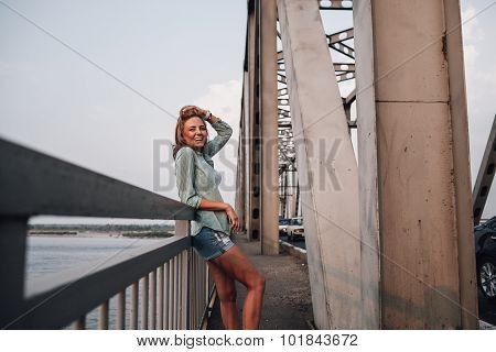portrait of woman on bridge