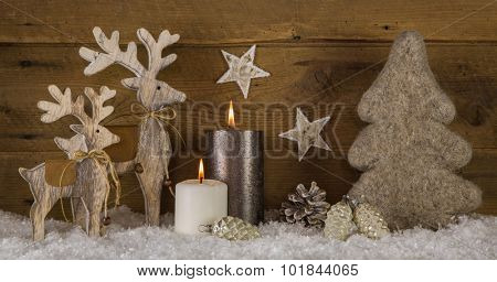 Natural wooden white brown christmas decoration with two burning candles.