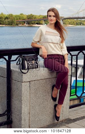 Tender Young Woman Sitting On The Pier