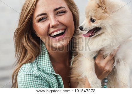 beautiful girl with her little cute dog