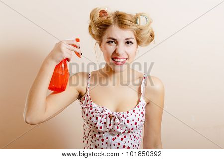 Housewife holding spray