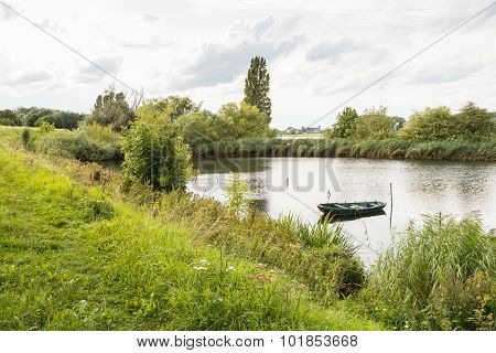 View With A Small Rowing Boat In The Water