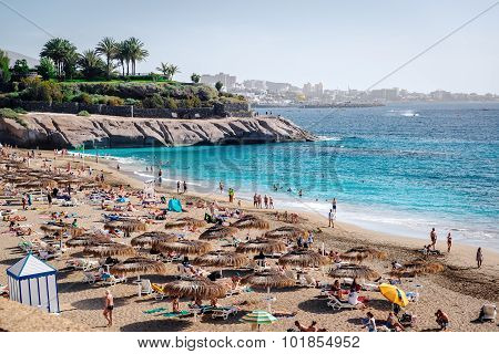 People Sunbathing On The El Duque Beach. Tenerife