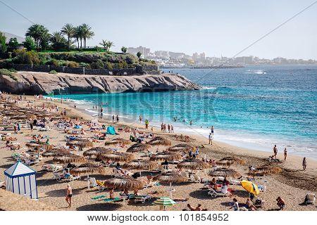 People Sunbathing On The El Duque Beach. Tenerife