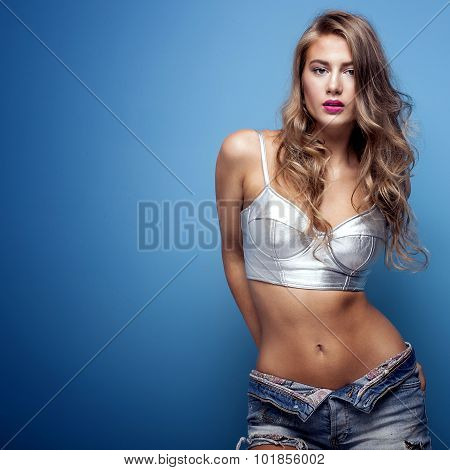Sexy Young Woman On Blue Background.