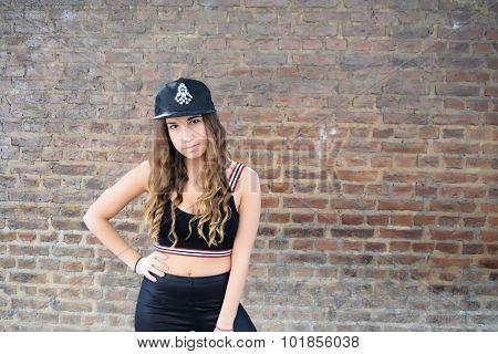 Portrait Of Hispanic Woman Against A Brick Wall.