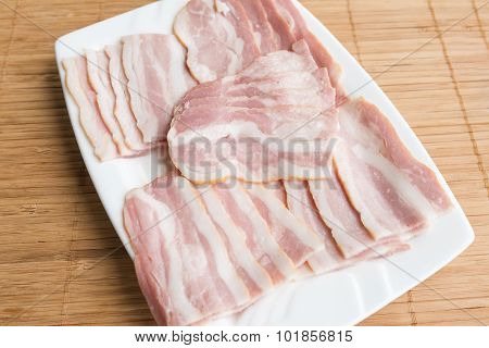Slided Bacon On White Dish For Gourmet