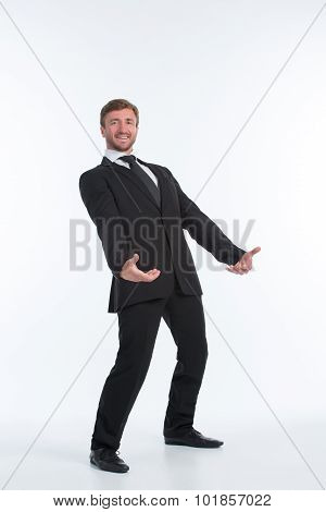 Businessman holding heavy load in front of him