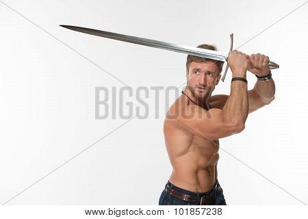 Bare-chested man with katana sword