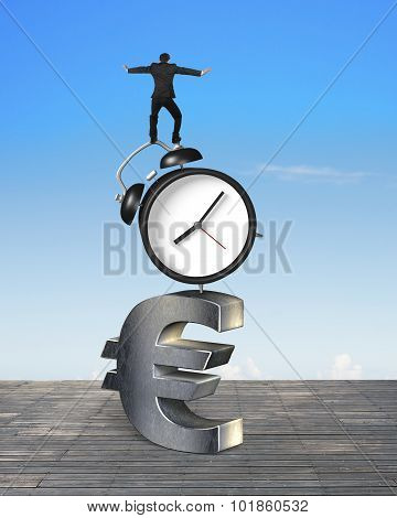 Businessman Balancing On Alarm Clock And Euro Sign
