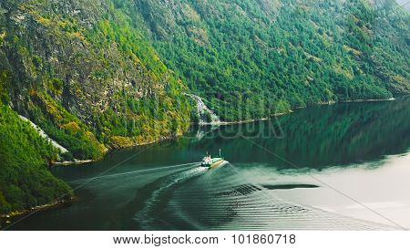 The ship floating in the water in narrowest fjord in Norway - Na