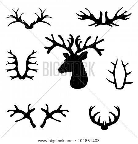 Set of black deer antlers on white background. Vector set.