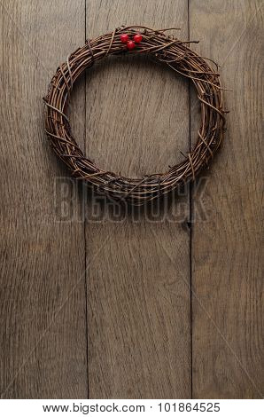Simple Christmas Twig Wreath Hanging  On Oak Plank Door