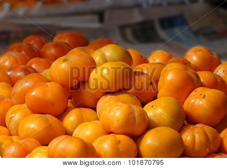 Ripe Persimmons For Sale At The Market