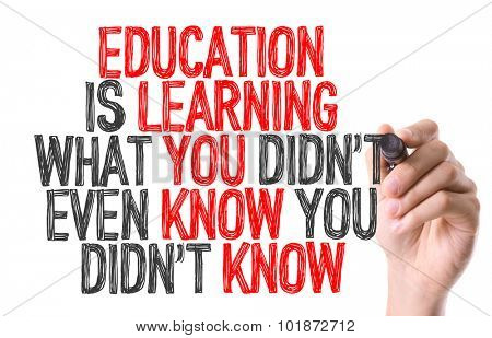 Hand with marker writing: Education is Learning What You Didn't Even Know You Didn't Know
