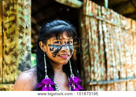 Native Brazilian girl smiling at an indigenous tribe in the Amazon