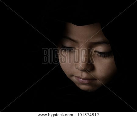 Nice Low Key striking sensitive Image of a Young Latino Girl on Black