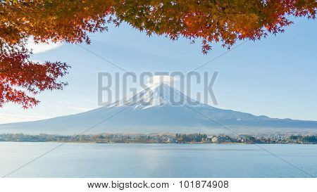Mount Fuji And Red Maple Leaves In Autumn At Kawaguchiko Lake Japan
