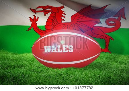 Wales rugby ball against wales flag