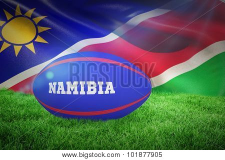 rugby ball for namibia against namibia flag waving in wind