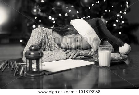 Monochrome Portrait Of Cute Girl Fell Asleep While Writing Letter To Santa