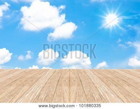 Cloudy Blue Sky With Sun Beam And Wood Floor