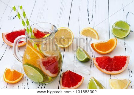 Detox citrus infused flavored water. Refreshing summer homemade cocktail with lemon lime orange and
