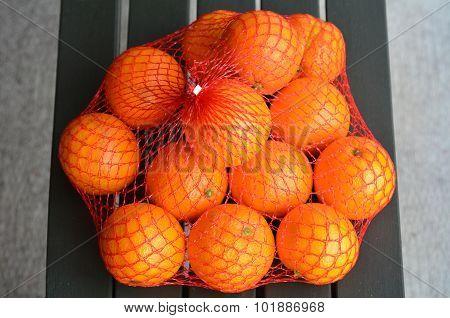Fresh Orange Oranges In Plastic Netting