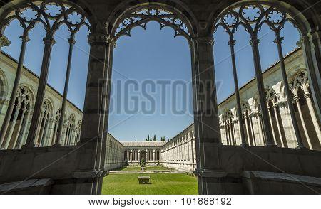 Pisa, Piazza dei Miracoli - gothic windows in  the monumental cemetery.
