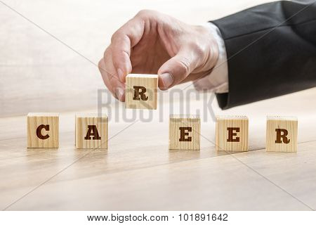Career Adviser Assembling The Word Career With Six Wooden Cubes