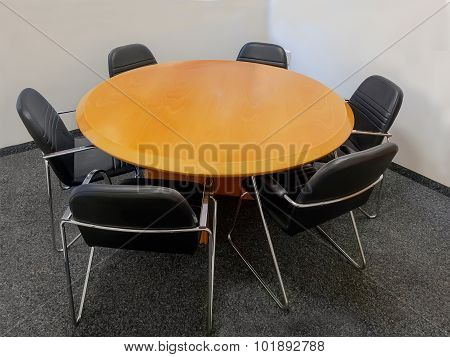 Meeting Table And Black Chairs