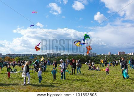 MOSCOW - AUGUST 30, 2015: People launch kites in Tsaritsyno Park on August 30, 2015 in Moscow Big kites in the sky