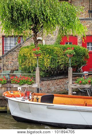 Boat on the waters of Bruges, Belgium
