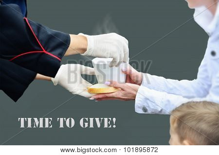 Hands In White Gloves Give A Cup Of Hot Soup To A Woman With Child.