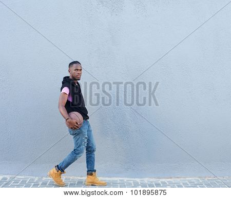 Cool Guy Walking Outside With Basketball