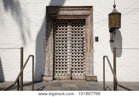 A beautiful antique wood and steel door with elaborate detail carvings. Wood doors have been used for centuries by humans to keep bad things outside and protect the ones indoors.
