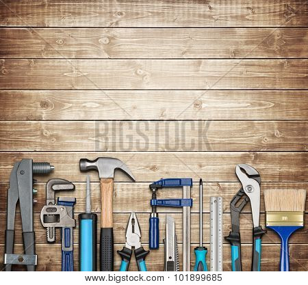 Various carpentry, repairing, DIY tools on wooden background