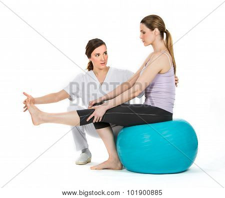 Doctor With Medical Ball And Woman Patient