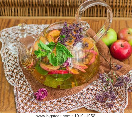 Herbal tea with apples, oregano, mint and rose. Selective focus
