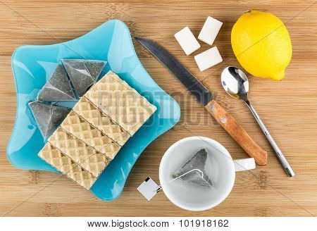 Blue Plate With Wafers And Tea Bags, Sugar, Lemon, Teacup