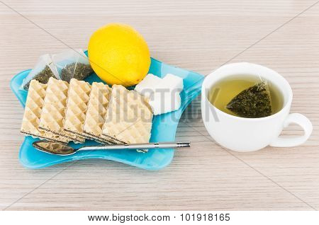 Plate With Wafers And Tea Bags, Sugar, Lemon And Teacup