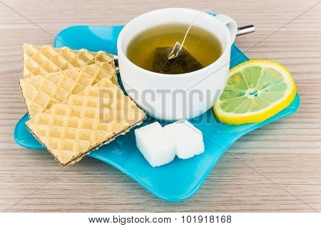 Tea With Wafers, Sugar And Lemon In Blue Plate