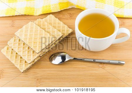 Hot Tea In Cup Wafers And Teaspoon On Table