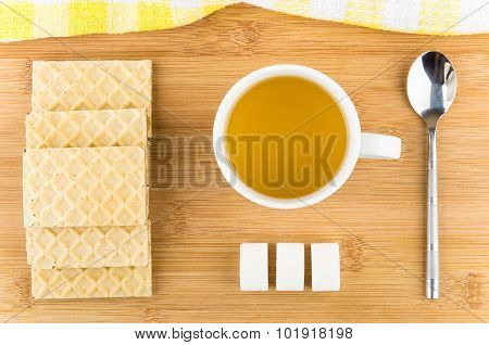 Hot Tea In Cup Wafers, Sugar And Teaspoon On Table