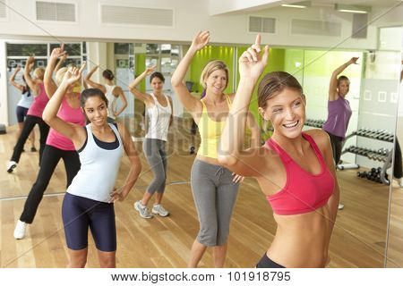 Women Taking Part In Zumba Class In Gym