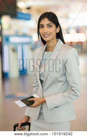 young business woman with passport and air ticket standing in airport