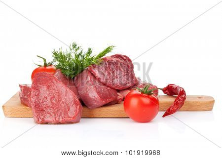 Raw fillet beef steak and spices on cutting board. Isolated on white background
