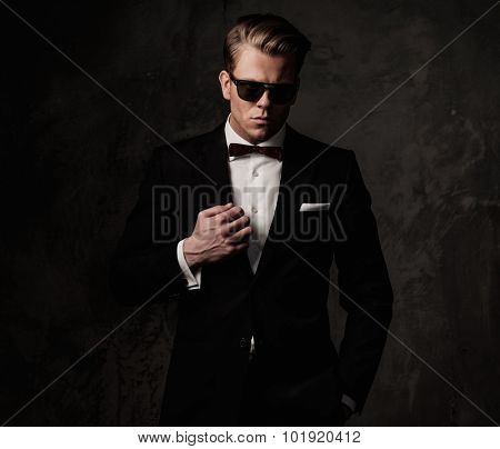 Tough sharp dressed man in black suit